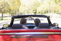 Couple in convertible car. Couple in red convertible car Royalty Free Stock Photos