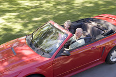 Couple in convertible car smiling Stock Image