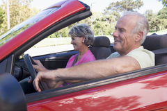 Couple in convertible car smiling Royalty Free Stock Photo