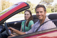 Couple in convertible car smiling Stock Photo