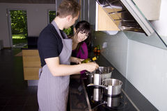 Couple cooking Stock Photos
