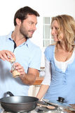 Couple cooking. Together in the kitchen Stock Photography