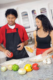 Couple cooking Stock Image