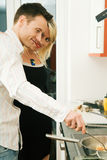 Couple cooking Royalty Free Stock Images