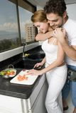 Couple cooking. A happy young couple cooking some vegetables Stock Images