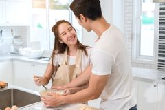Couple cooking bakery in kitchen room, Young asian man and woman together stock photos