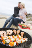 Couple Cooking Beach Barbeque stock image