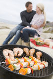 Couple Cooking Beach Barbeque stock photography