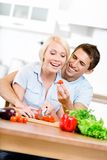 Couple cooking breakfast together Royalty Free Stock Photography