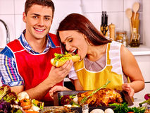 Couple cooking chicken at kitchen Royalty Free Stock Image