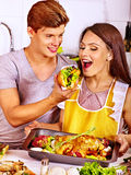 Couple cooking chicken at kitchen. Stock Image