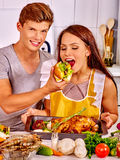 Couple cooking chicken at kitchen Stock Images