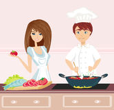 Couple cooking dinner Stock Photography