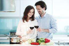 Couple cooking dinner royalty free stock images