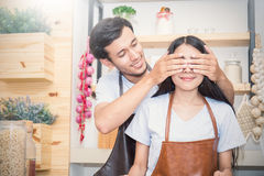 Couple cooking dinner in their kitchen Royalty Free Stock Photography