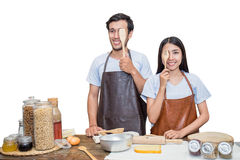 Couple cooking dinner in their kitchen Royalty Free Stock Photo