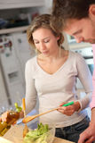 Couple cooking dinner together Royalty Free Stock Image