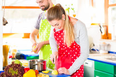 Couple cooking in domestic kitchen healthy food Stock Image