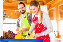 Couple cooking in domestic kitchen healthy food Royalty Free Stock Photo