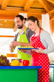 Couple cooking in domestic kitchen healthy food Royalty Free Stock Image