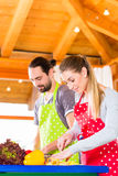 Couple cooking in domestic kitchen healthy food Royalty Free Stock Photography