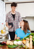 Couple cooking with eBook Stock Photos