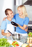 Couple cooking eggplant Royalty Free Stock Images