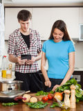 Couple cooking with electronic Book Stock Photo