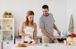 Couple cooking food at home kitchen Stock Image
