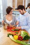 Couple Cooking Food in Kitchen. Healthy lifestyle Stock Image