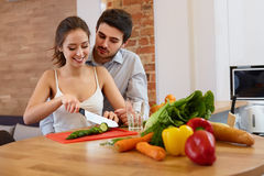 Couple Cooking Food in Kitchen. Healthy lifestyle Royalty Free Stock Photos