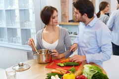 Couple Cooking Food in Kitchen. Healthy lifestyle Royalty Free Stock Photo