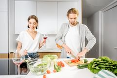 Couple cooking food at the kitchen home stock photos