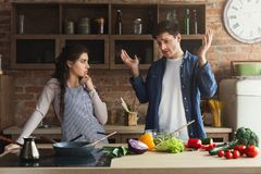 Couple cooking healthy dinner together Royalty Free Stock Photo