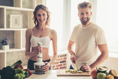 Couple cooking healthy food stock photography