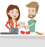 Couple cooking healthy vegetable meal. Stock Images