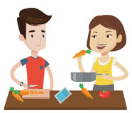 Couple cooking healthy vegetable meal. Royalty Free Stock Images