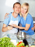 Couple cooking at home Royalty Free Stock Image