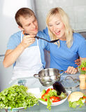 Couple cooking at home Stock Photography