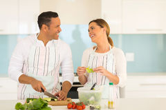 Couple cooking at home Stock Images