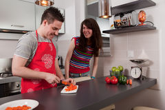 Couple cooking the in kitchen Stock Photo