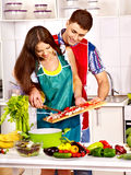 Couple cooking at kitchen. Stock Images