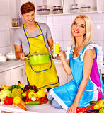 Couple cooking at kitchen royalty free stock photo