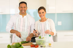 Couple cooking in kitchen Stock Image