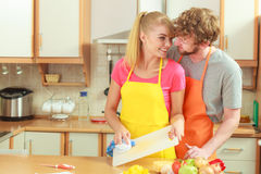 Couple cooking in kitchen, preparing meal Royalty Free Stock Photo