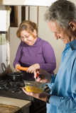 Couple Cooking in the Kitchen-Vertical. Royalty Free Stock Images