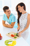 Couple cooking in the kitchen stock photography