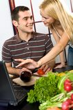 Couple cooking with laptop Royalty Free Stock Image