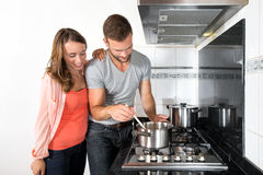 Couple Cooking A Meal On Stove royalty free stock photo
