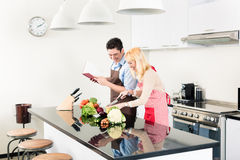 Couple cooking in stylish and modern kitchen Royalty Free Stock Photos